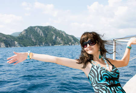 Happy young woman on holidays on the sea Stock Photo - 14409887