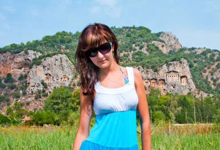 europe eastern: Young woman in famous Lycian Tombs of ancient Caunos city, Dalyan, Turkey