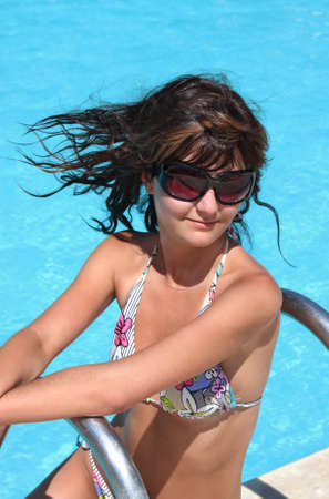 Young beautiful woman in water of pool Stock Photo - 14732104