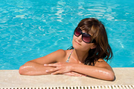 Young beautiful woman in water of pool Stock Photo - 14732110