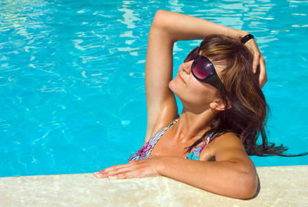 Young beautiful woman in water of pool Stock Photo - 14732106