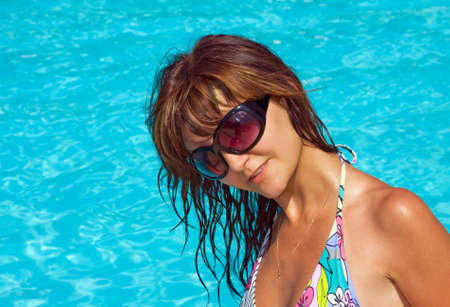 Young beautiful woman in water of pool Stock Photo - 14732115