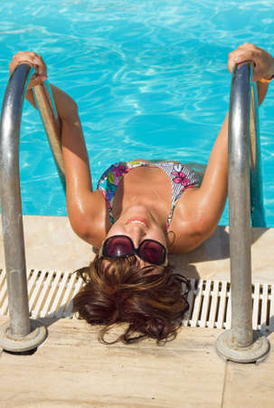 Young beautiful woman in water of pool photo