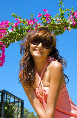 Happy young woman on holidays on resort of Turkey, in floral garden photo