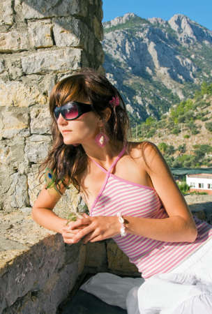 superstructure: Young woman on holidays on resort of Turkey on derrick superstructure