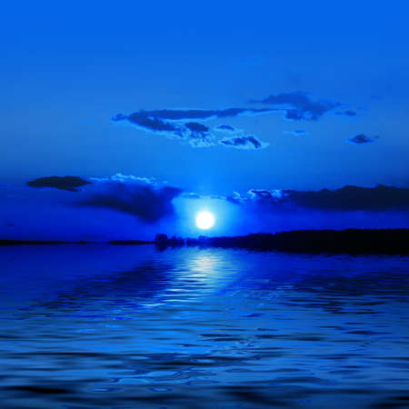 Blue evening on river, moon and water Stock Photo