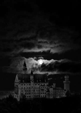 Night cloudy landscape with castle  and moon. Germany photo