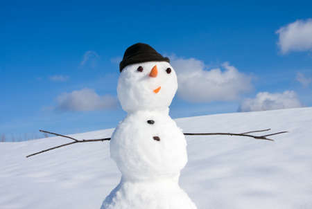 snow scenes: Snow man on nature in sunny cold day Stock Photo