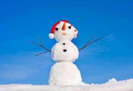 Snow man in santa cap on nature in sunny cold day Stock Photo - 15913752