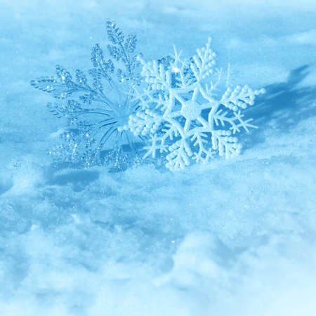 Christmas decorations  snowflakes on a snow background of nature photo