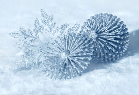 Christmas decorations on a snow background of nature photo