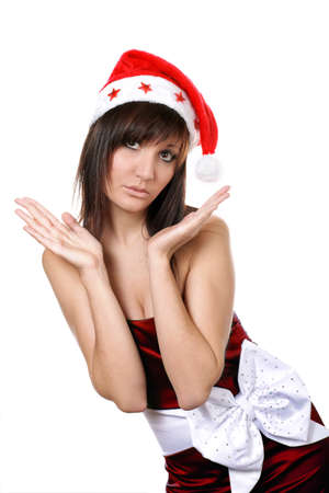Charming young woman in santa cap. Fashion studio portrait photo