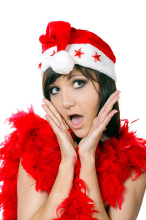 exclaim: Young woman with open-mouthed of surprise in santa cap. Fashion studio portrait