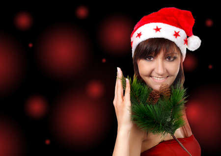 Charming young woman in santa cap, congratulatory card photo
