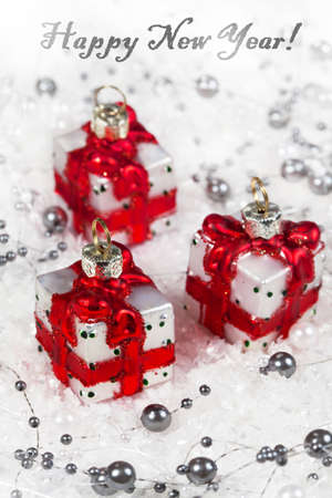 Christmas decorations on a snow background, gifts photo