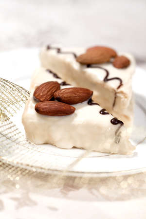 Tasty  cakes with almond for dessert on a holiday and Christmas decor photo
