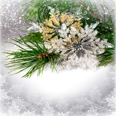 Christmas decorations two snowflakes and snow for design postcard photo