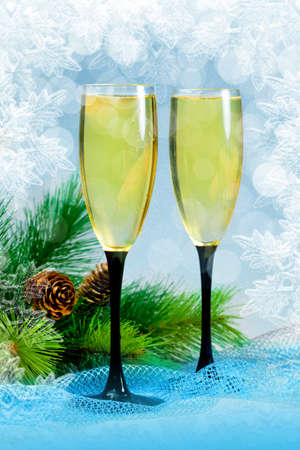 Christmas tree and champagne in two glasses photo