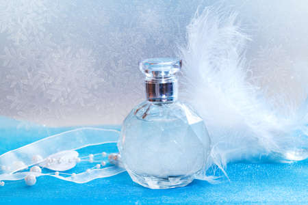 christmas perfume: Christmas decorations and bottle of perfume close-up