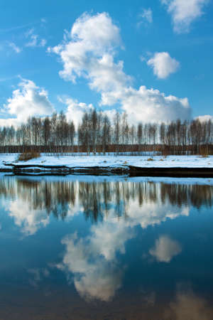 Spring landscape, river and reflected clouds Stock Photo - 16566609