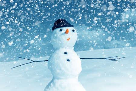 winter scene: Snow man in santa cap on nature in sunny cold day Stock Photo