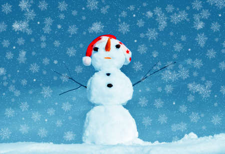 Snow man in santa cap on nature in sunny cold day Stock Photo - 16690653