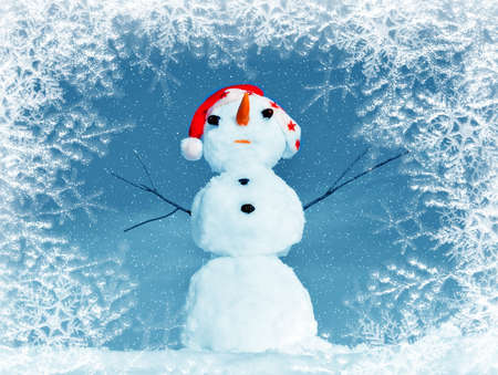 Snow man in santa cap on nature in sunny cold day Stock Photo - 16690654
