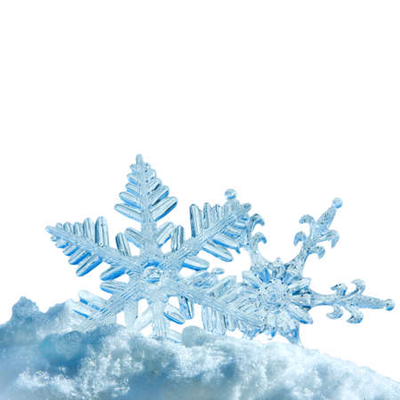 Christmas snowflakes in snow, isolated over white photo
