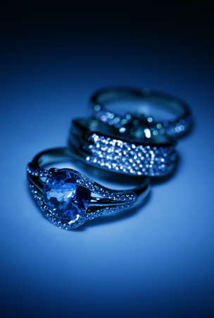 jewelle: Jewelry accessories - golden rings in blue light