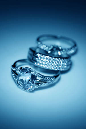 Jewelry accessories - golden rings in blue light photo