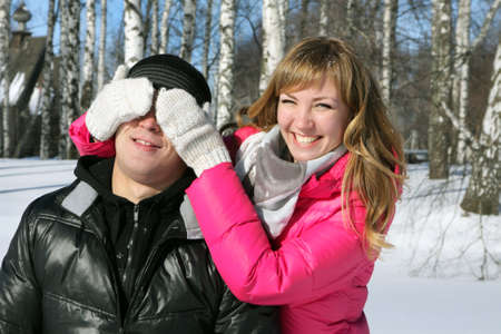 Young loving couple on appointment on the nature, winter season photo
