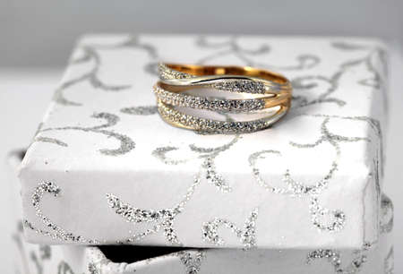 jewelle: Golden jewelry accessories  with brilliants on white box Stock Photo