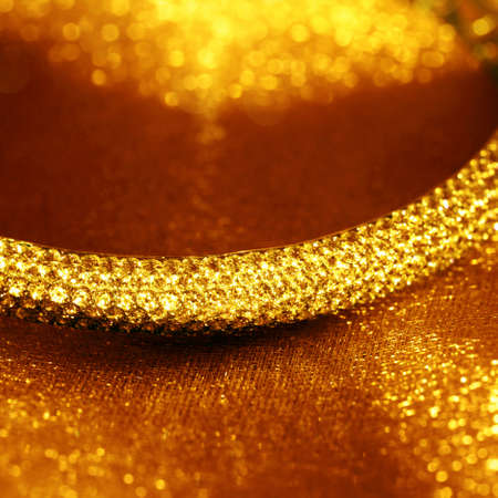 jewelle: Golden jewelry accessories  with brilliants on background Stock Photo