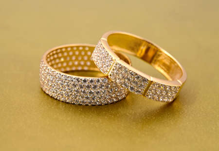 jewelle: Golden jewelry accessories  with brilliants on golden background