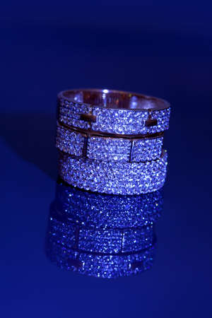 jewelle: Golden jewelry accessories  with brilliants on blue dark background