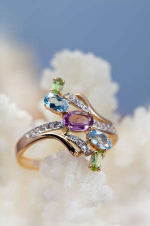 jewelle: Golden  ring with topaz, amethyst, brilliants on coral reef