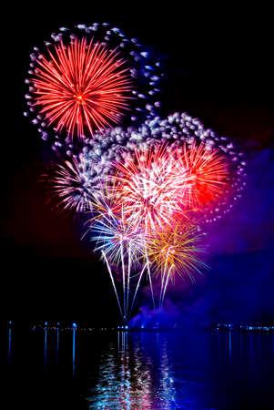 celebratory: Celebratory bright firework in a night sky  Stock Photo
