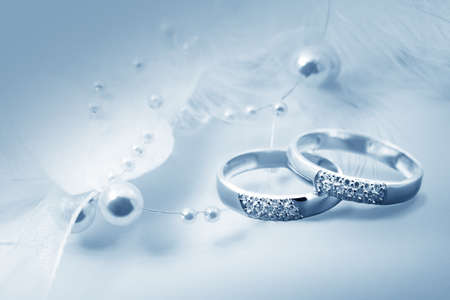 Wedding rings on blue background for card photo