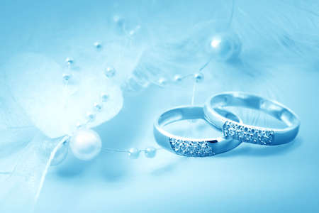 goldy: Wedding rings on blue background for card