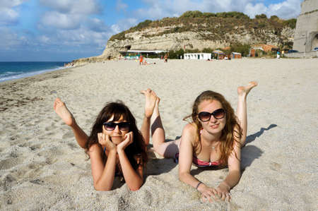 Young active women - girl friends on a beach, Italy  photo