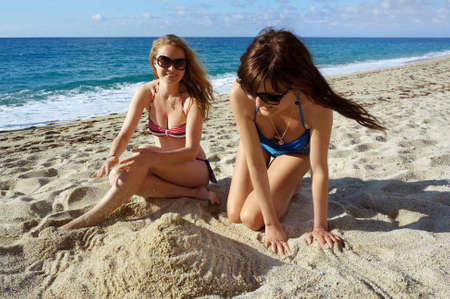 Young active women - girl friends on a beach  photo