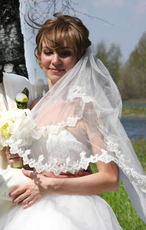 Young bride in wedding day on a nature