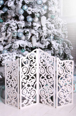 Christmas tree and decorations for winter holidays