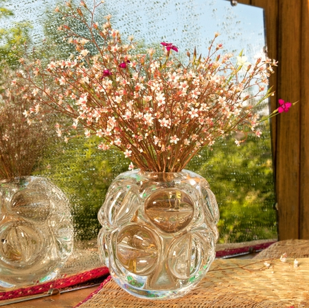 still life of the pink wild flowers with mirror and water drops photo