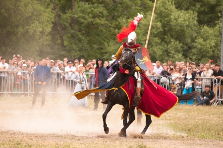 Moscow, Russia - June 23, 2013: Times and Epoch-2013 festival in Kolomenskoye park. The Middle Ages (Srednevekove). Knight on a horse in a historical reconstruction on the joust.