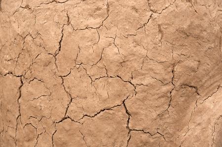 earthen: cracked earthen wall background Stock Photo