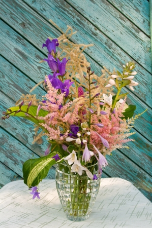 Still life bouquet with astilbe, hosta and bluebells photo