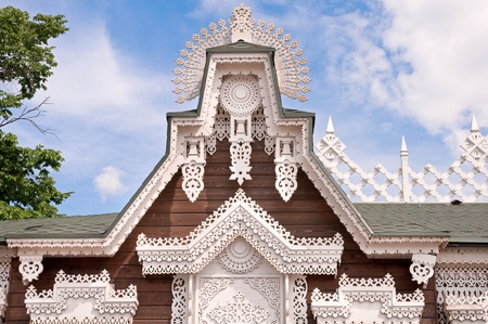 openwork tracery wooden house roof photo