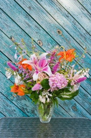 still life bouquet  lily, hosta, astilbe, hemerocallis and pink hydrangea photo