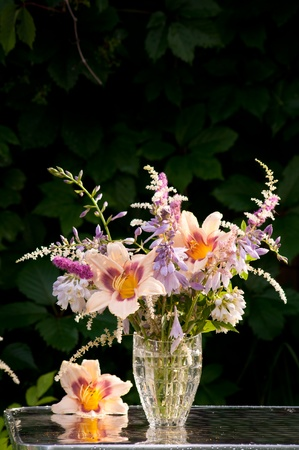 still life bouquet with hemerocallis in a dark background photo
